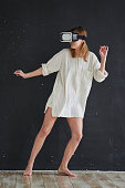 Girl in a virtual reality helmet