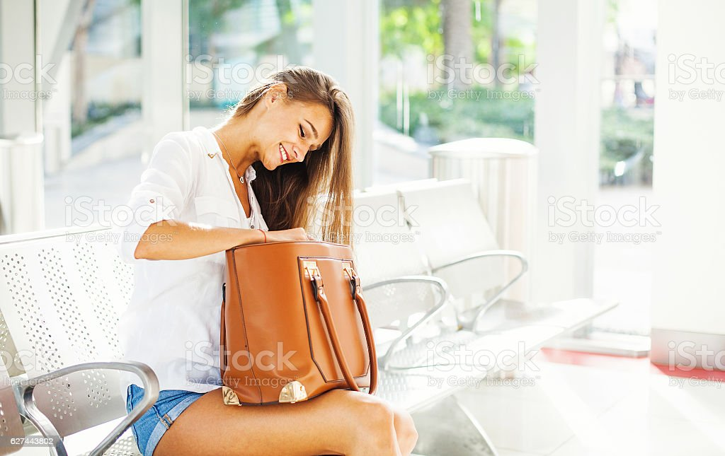 girl in a waiting hall stock photo