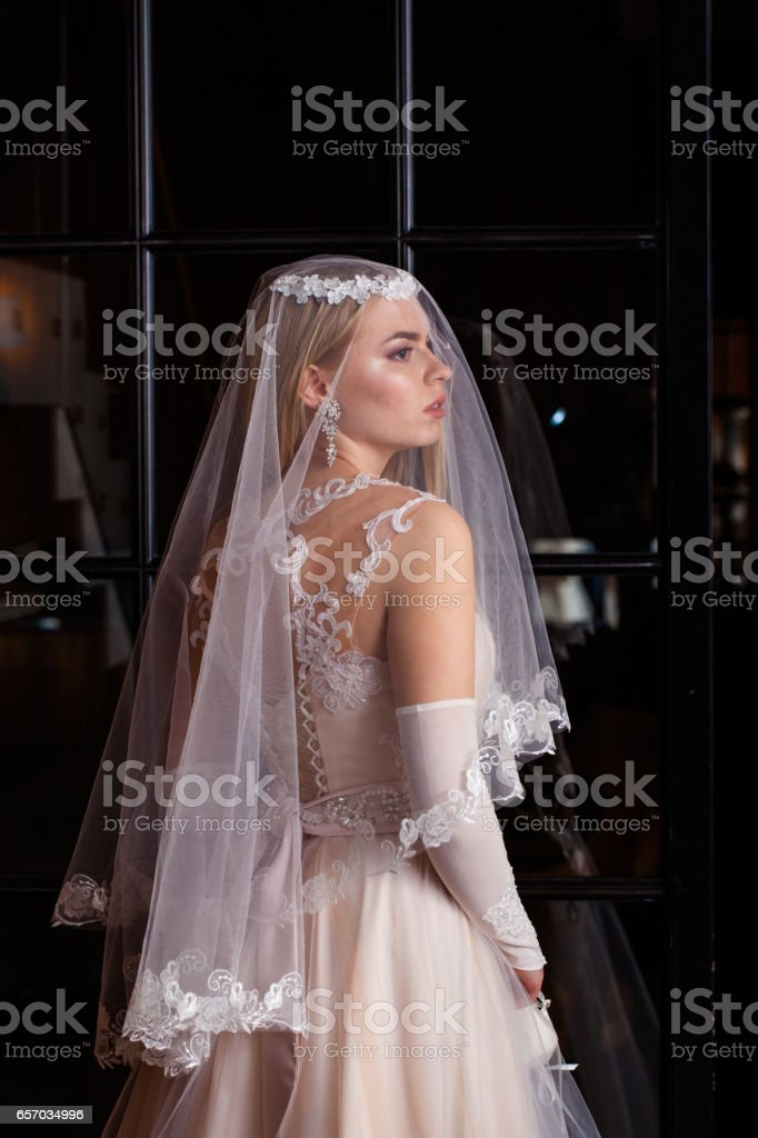 Girl in a wedding dress stock photo