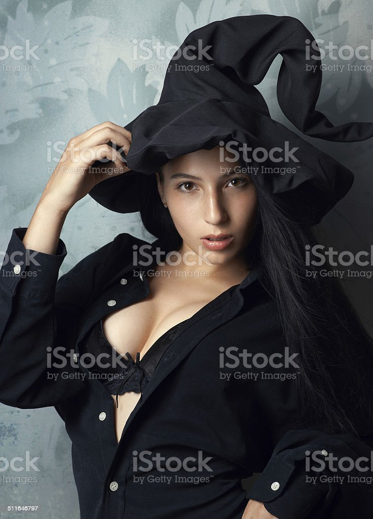 girl in a witch costume sexy looks stock photo