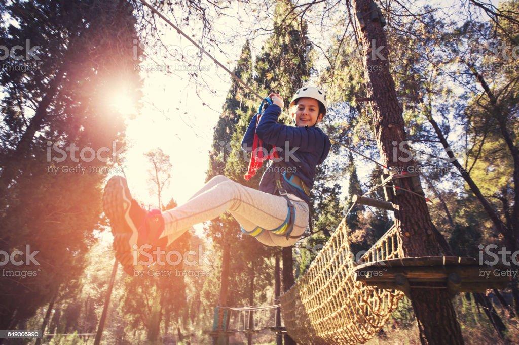 Girl in adventure park stock photo