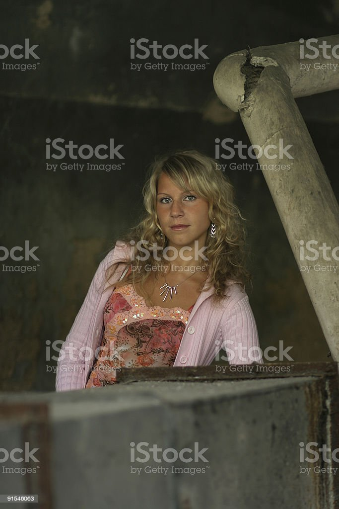 Girl in an old industry setting stock photo