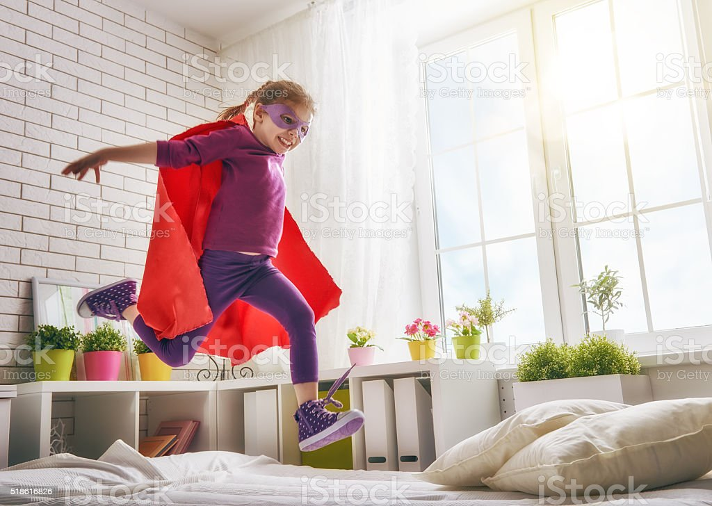 girl in an Superman's costume stock photo