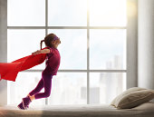girl in an Superman's costume