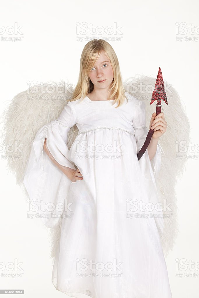 Girl in angel costume with devil's tail on white background royalty-free stock photo