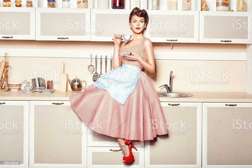 Girl in apron stock photo