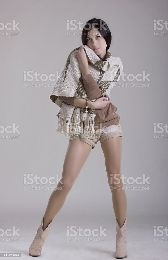 Girl in autumn clothers on white background. stock photo