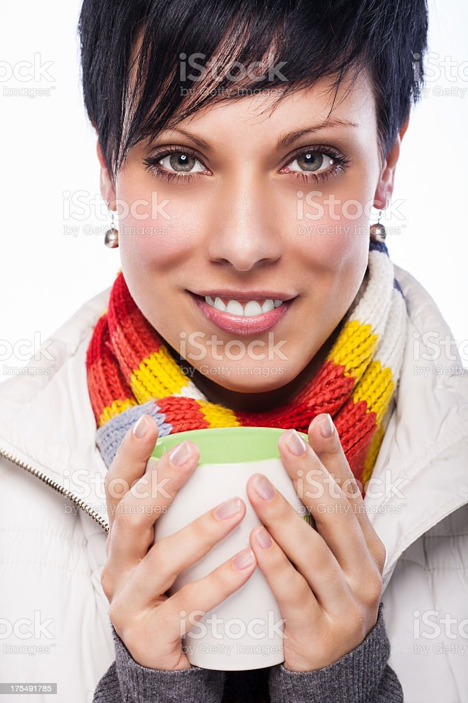 Girl in autumn clothes holding warm drink royalty-free stock photo