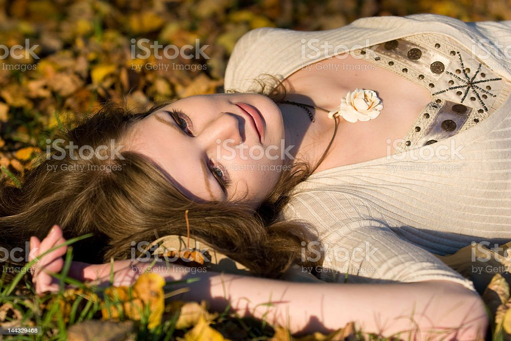 Girl in autunm leaves royalty-free stock photo