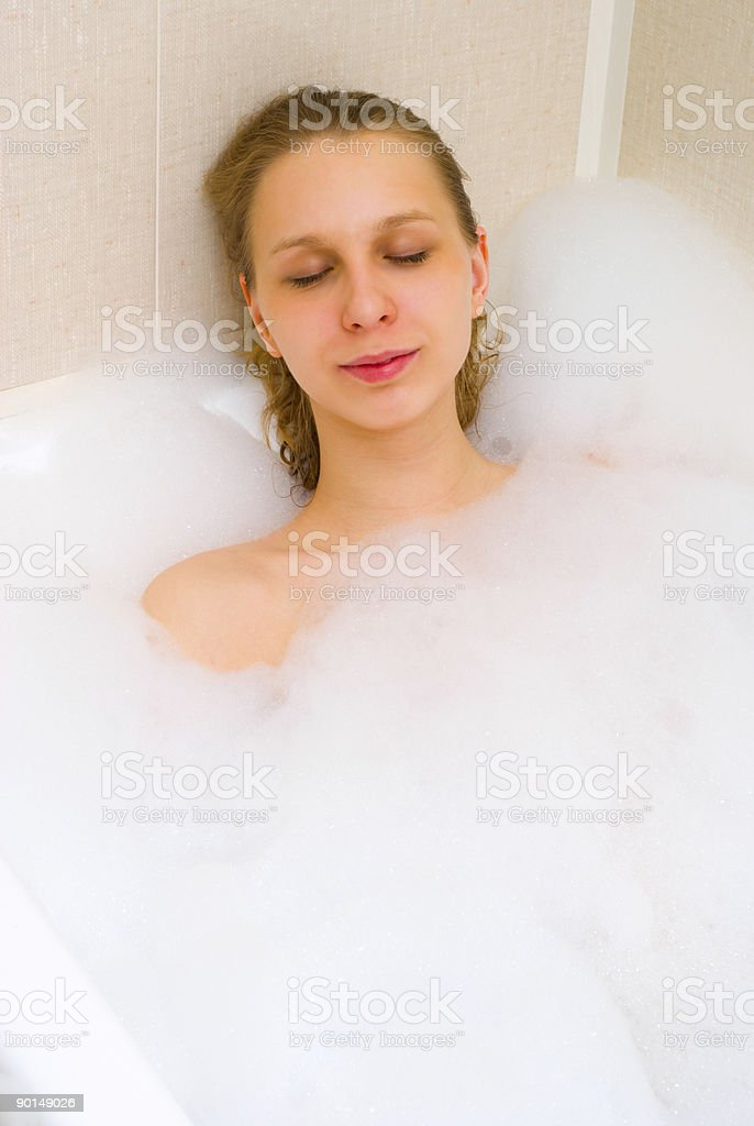 Girl in bath foam royalty-free stock photo