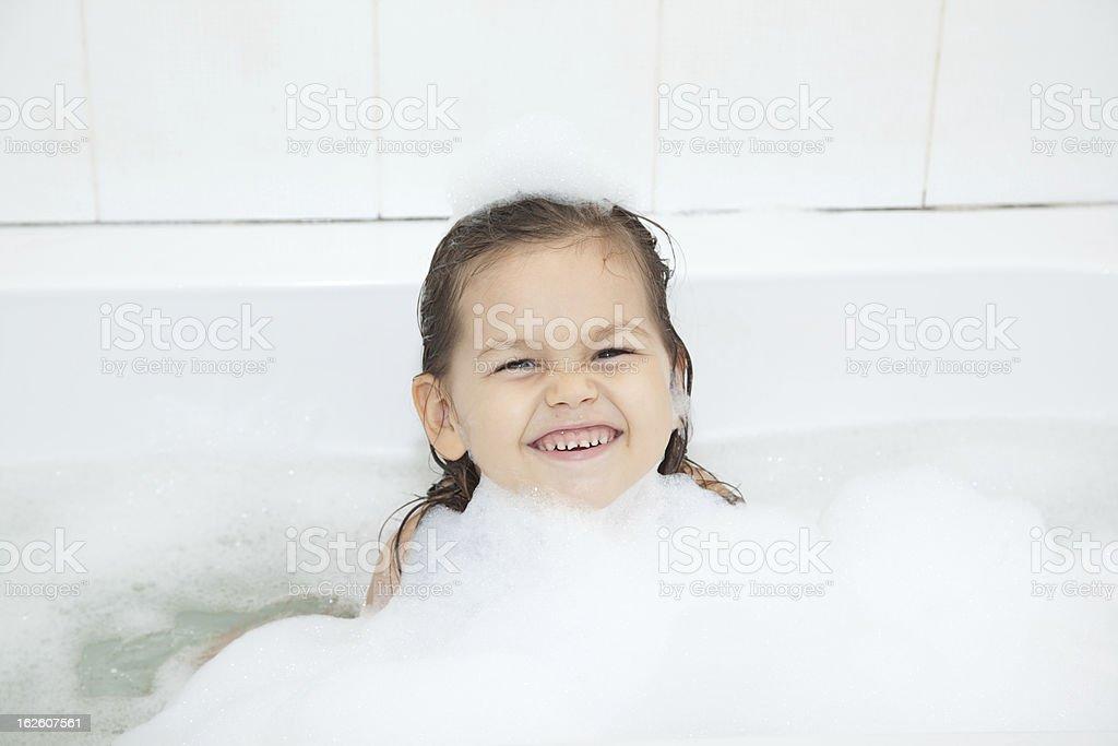 Girl in bath stock photo