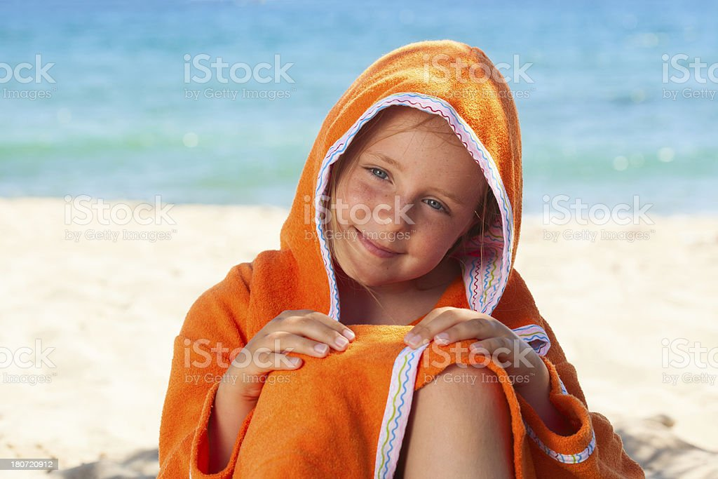 Girl in bathrobe on beach royalty-free stock photo