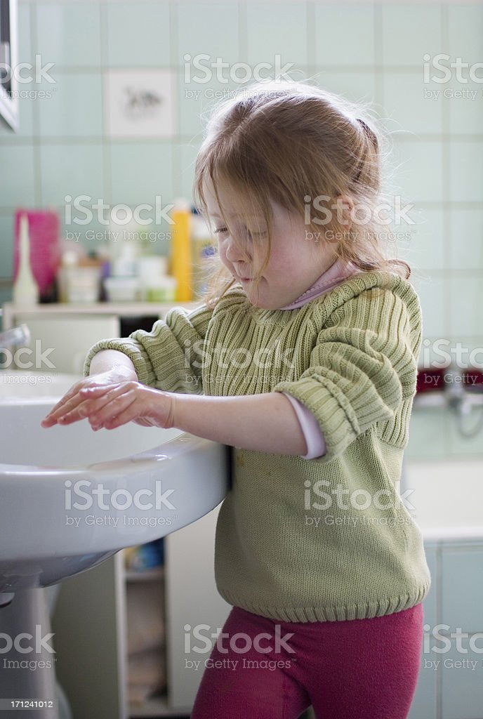 girl in bathroom, washing hands royalty-free stock photo