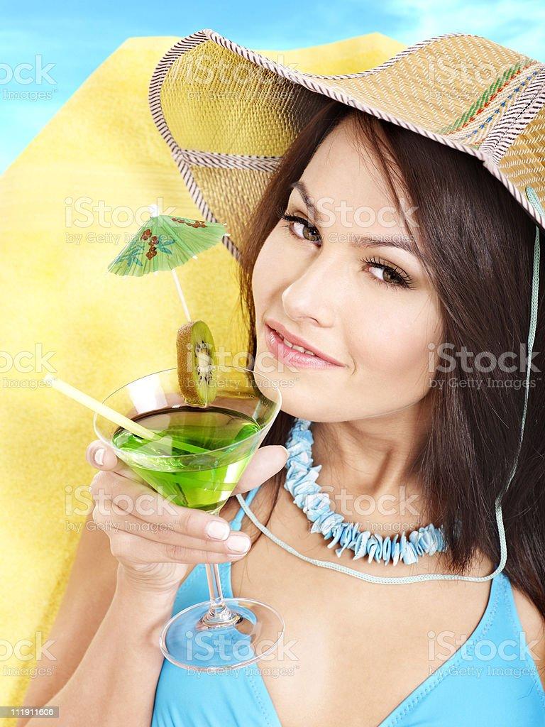 Girl in bikini drink beverage through a straw. stock photo