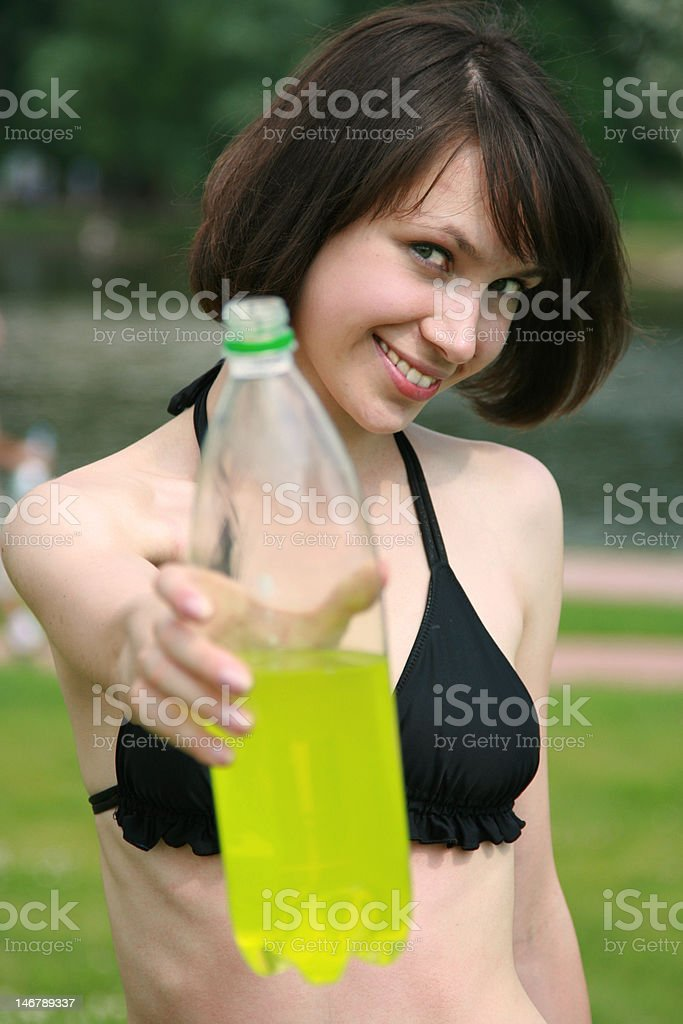 girl in bikini with a bottle royalty-free stock photo