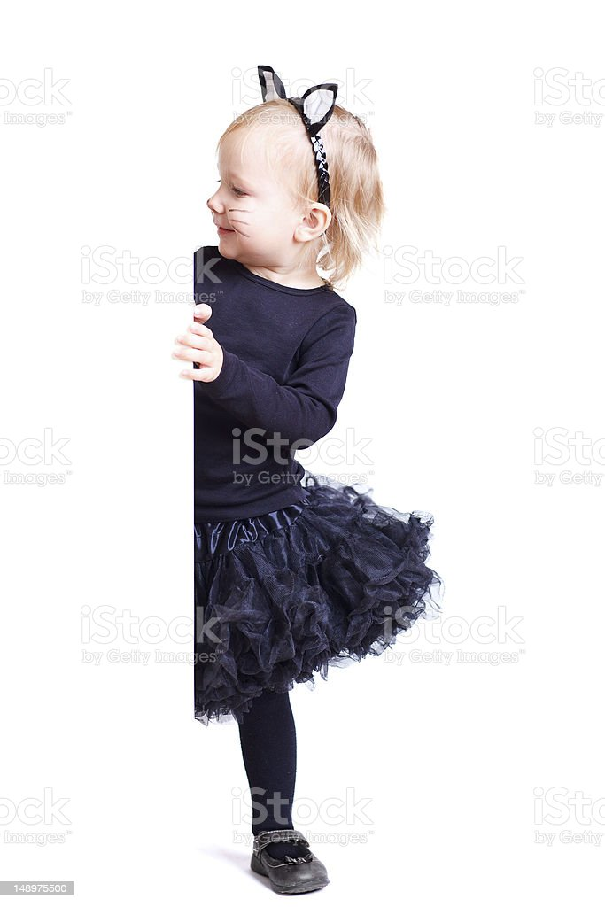 Girl in black cat costume stock photo