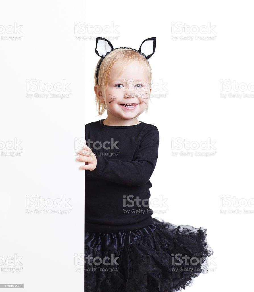 Girl in black cat costume with banner stock photo