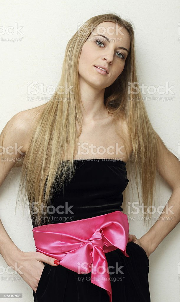 Girl in black dress with pink bow stock photo