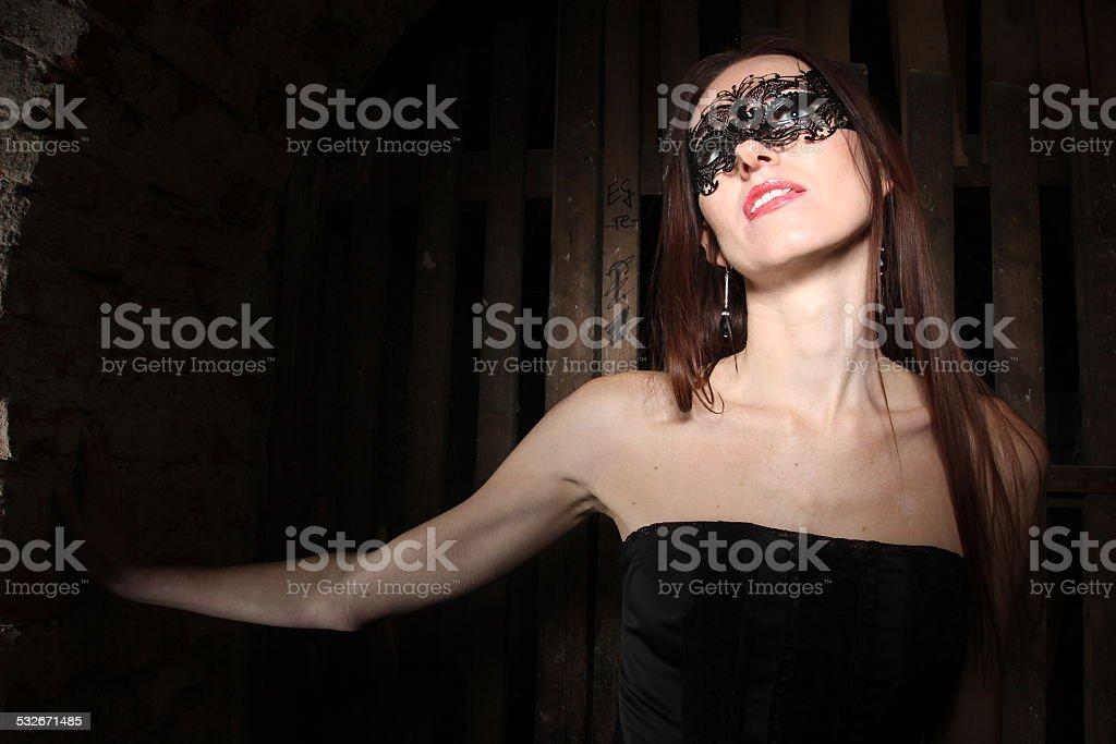 Girl in black mask stock photo