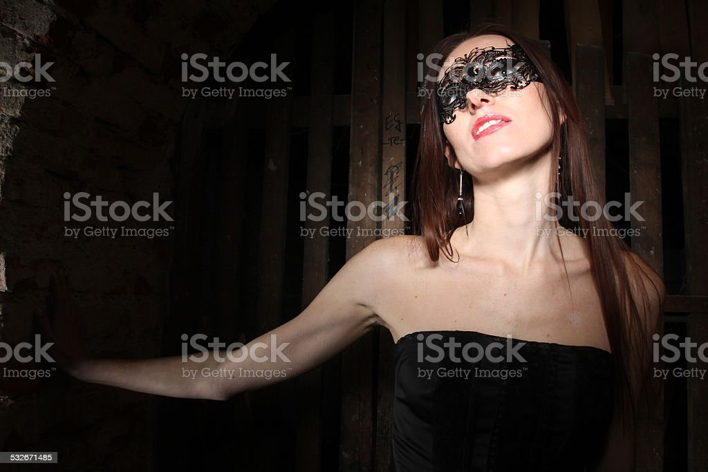 Girl in black mask stock photo