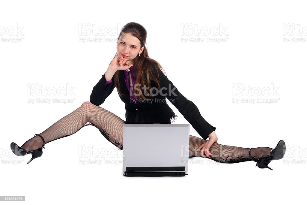 Girl in black suit with notebook sits on floor. royalty-free stock photo