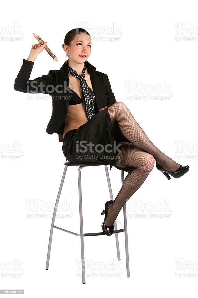Girl in black suit with pencil thinks. royalty-free stock photo