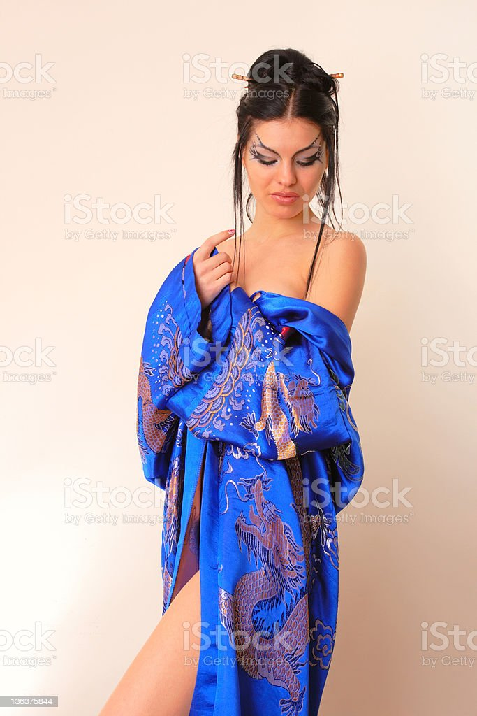 girl in blue asian bathrobe with dragons royalty-free stock photo