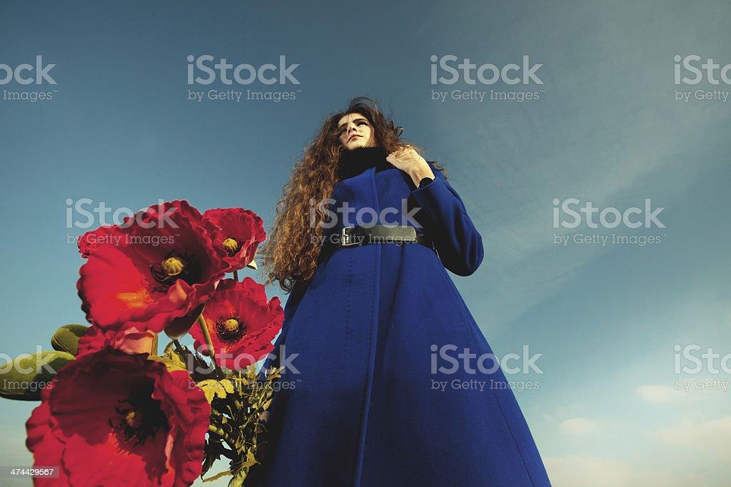 Girl in blue coat stock photo
