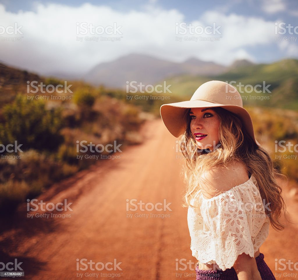 Girl in boho fashion in a natural landscape stock photo