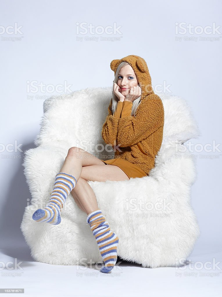 girl in brown plush hud sitting on  arm-chair royalty-free stock photo