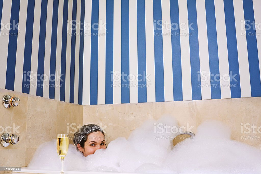Girl in bubble bath royalty-free stock photo