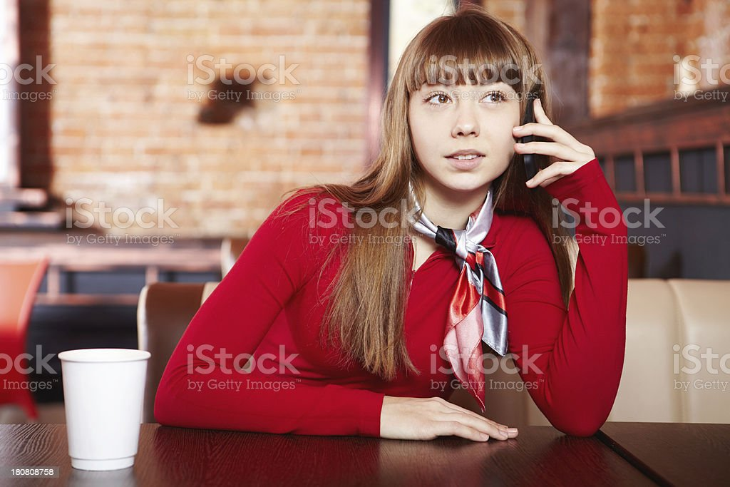 Girl in cafe. On the phone. royalty-free stock photo