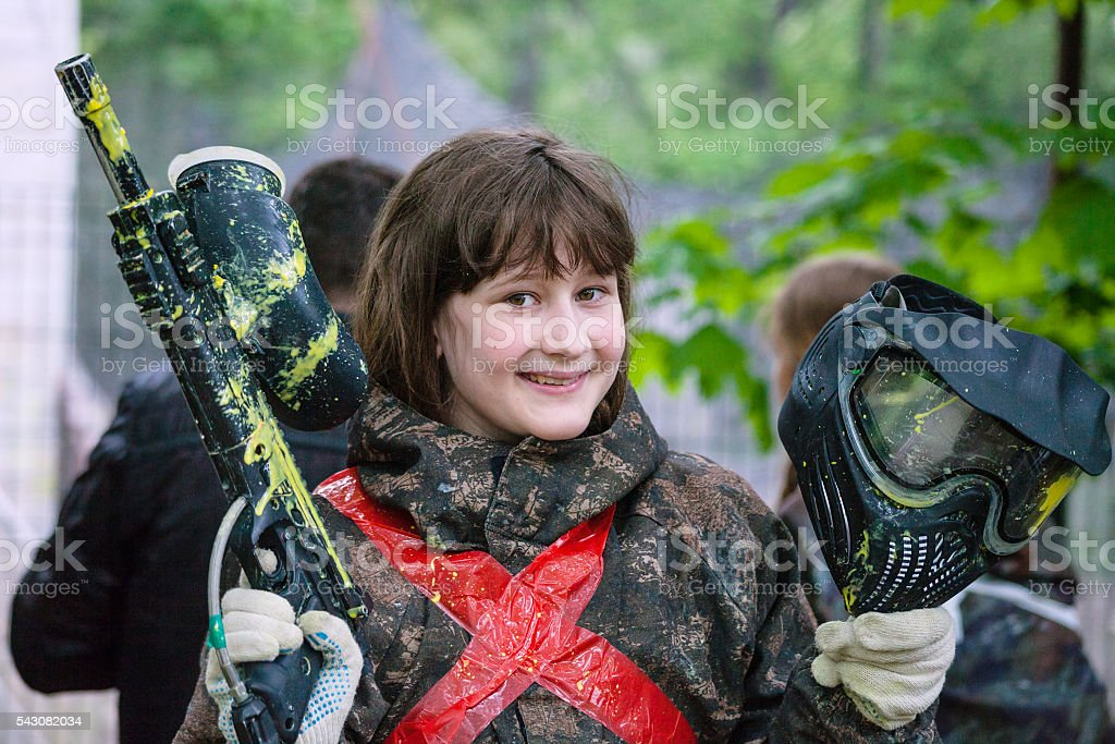girl in camouflage after paintball game stock photo