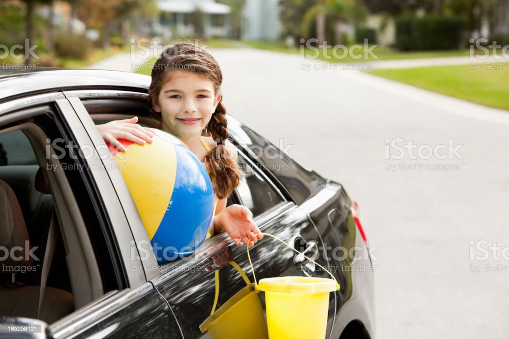 Girl in car ready for trip to beach stock photo