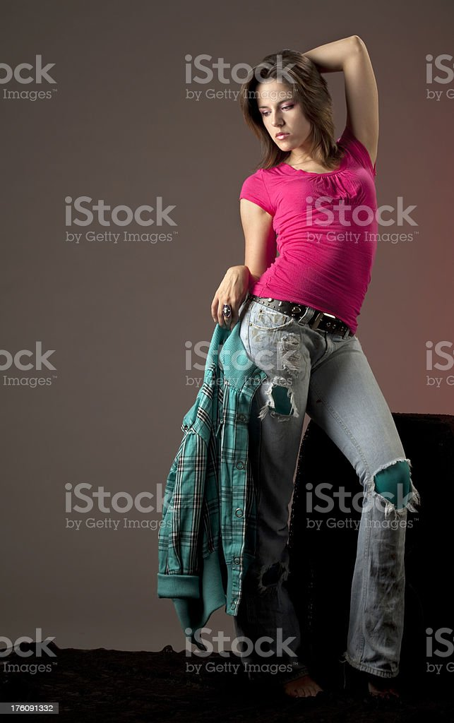 Girl in Casual Cloths With Ripped Torn Jeans, Pink, Green royalty-free stock photo