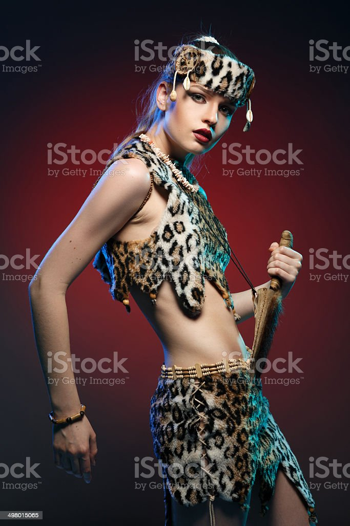 Girl in clothes Amazons with a knife in his hand. royalty-free stock photo