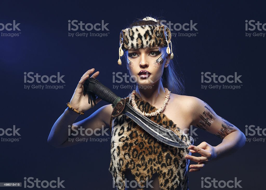 Girl in clothes Amazons with a sword in his hand. royalty-free stock photo