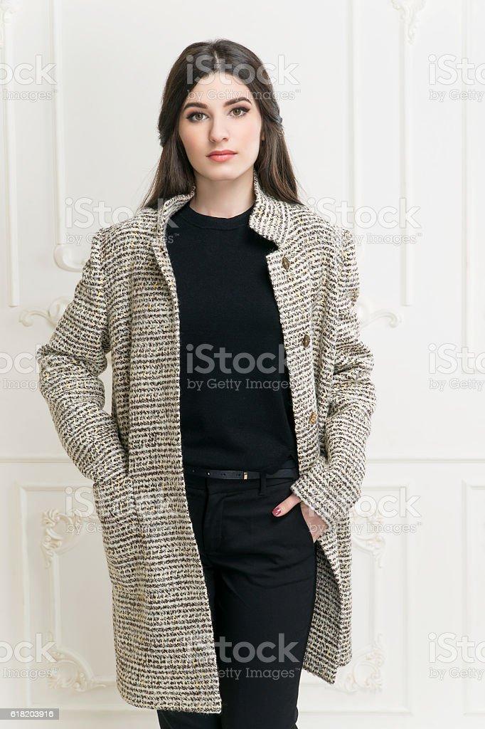 Girl in coat stock photo