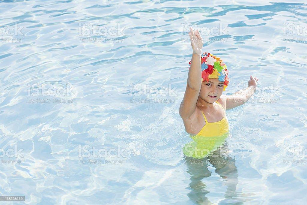 Girl in colorful swim cap royalty-free stock photo