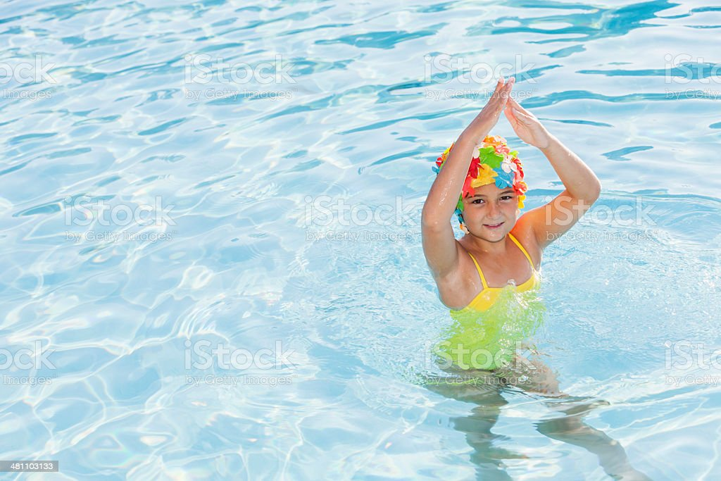 Girl in colorful swim cap stock photo