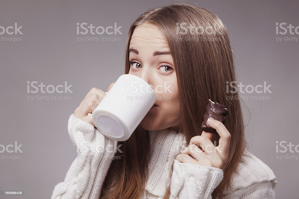 Girl in Comfy Sweater Holding Mug royalty-free stock photo
