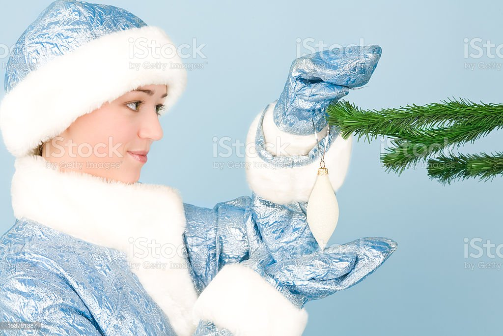 Girl in costume with new year toys royalty-free stock photo