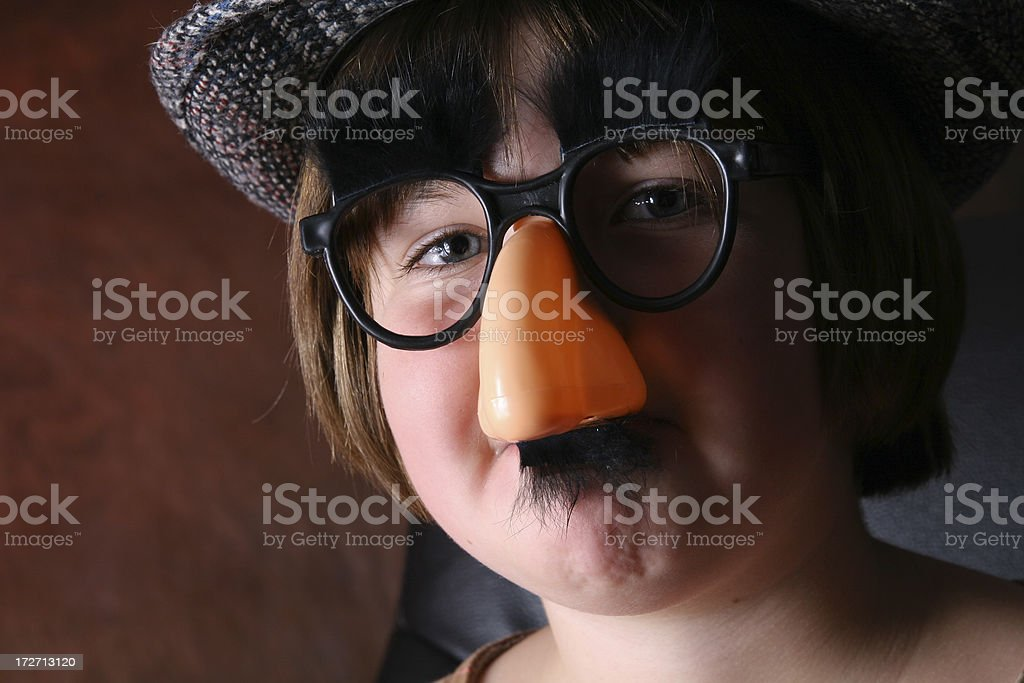 Girl in disguise Identity theft humor stock photo