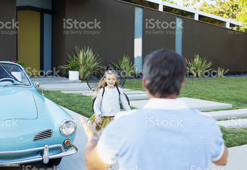 Girl in fairy wings running to father royalty-free stock photo