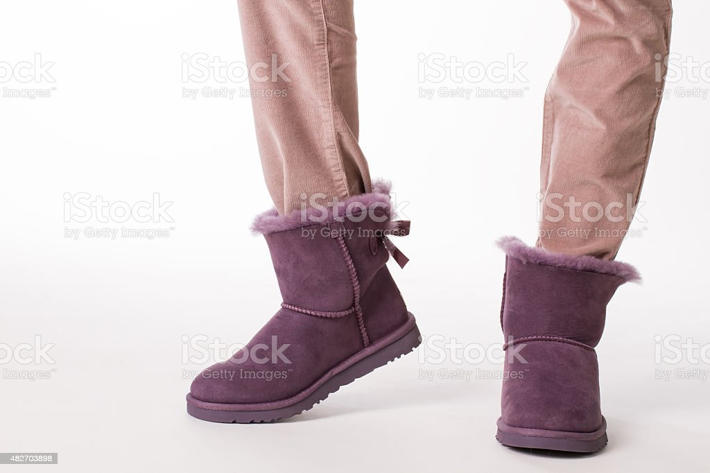 Girl in fashion winter boots. stock photo