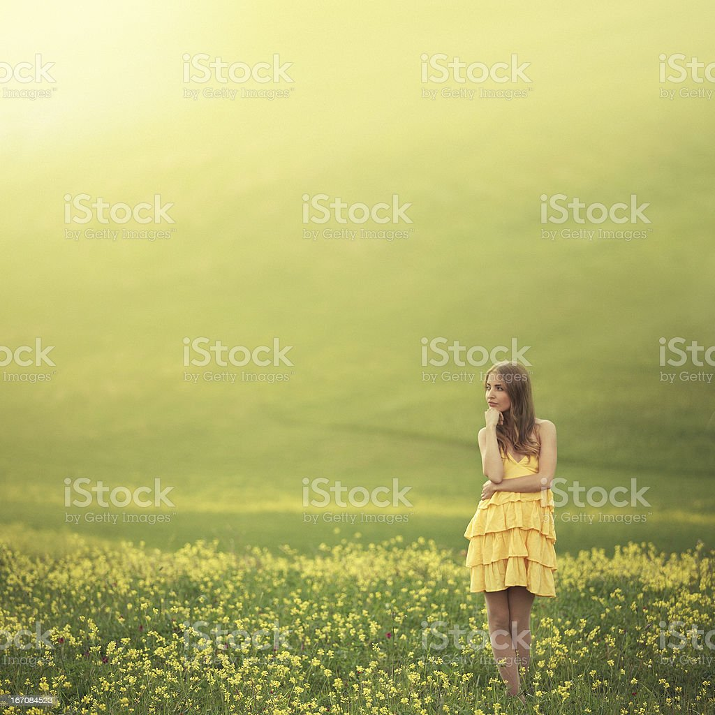 girl in flower covered field royalty-free stock photo