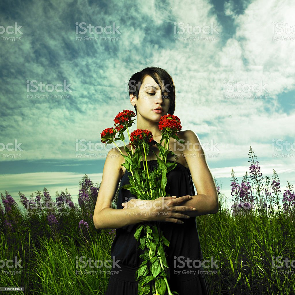 Girl in flower meadow royalty-free stock photo