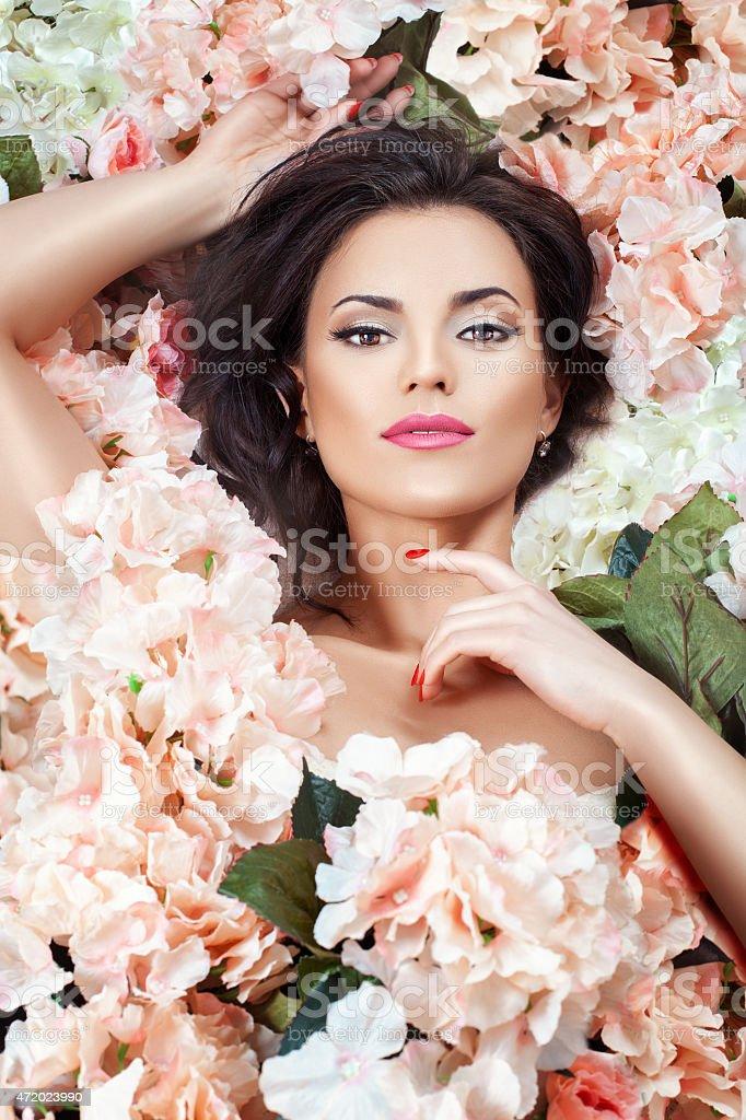 Girl in flowers gentle. stock photo