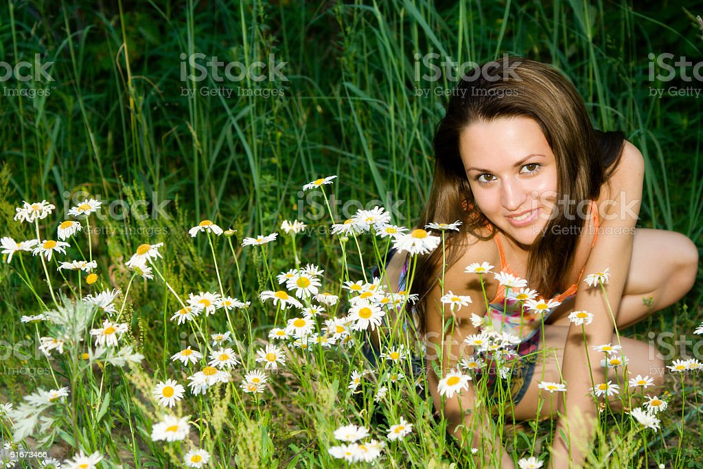 Girl in flowers royalty-free stock photo