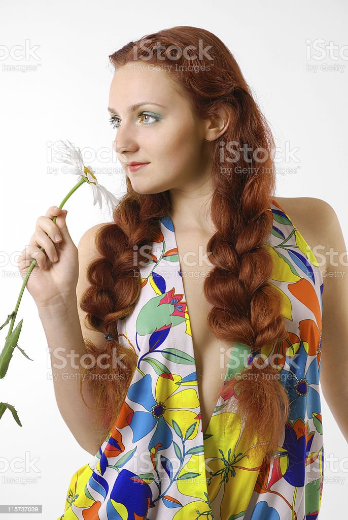 Girl in flowery dress with flower. stock photo